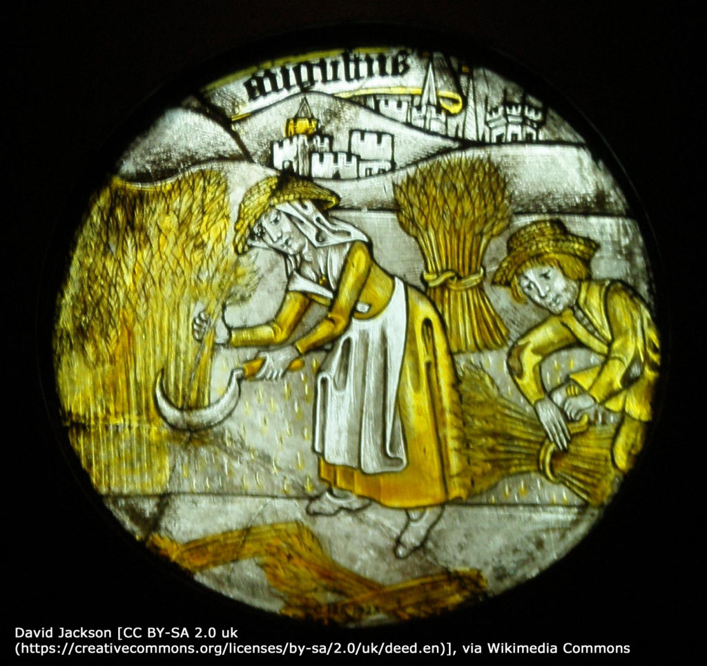 Photo of stained glass window showing a peasant using a sickle